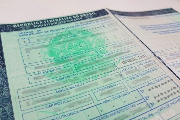 Já que posso imprimir o CRLV em casa, por que preciso pagar a taxa de licenciamento?